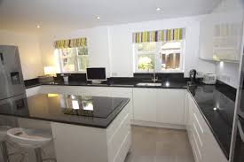 grey kitchen cupboards with black worktop black silver and white kitchen decor house