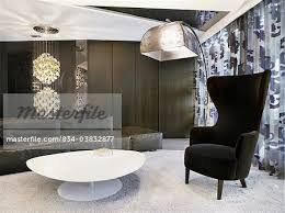 High Back Living Room Chair Modern Living Room With White Coffee Table And Black High Back