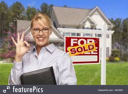 real estate agent in front of sold sign and house image