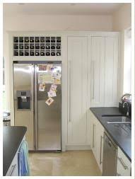 i like the wine rack above the fridge and integrated cooker and