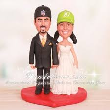 athletics and raiders wedding cake toppers