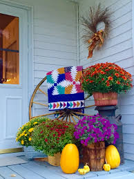 Fall Outdoor Decorations by Autumn Porch Display With Old Milk Can An Old Wagon Wheel An Old