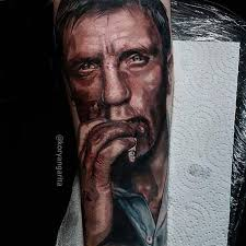 realistic james bond daniel craig inspired tattoo on the left