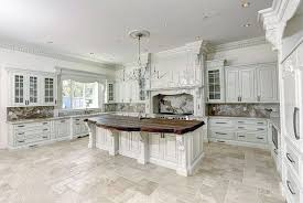 Kitchen Chandelier Lighting Traditional Kitchen With White Cabinets Honed Travertine Floors