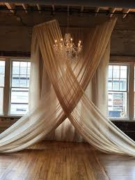 wedding backdrop chagne these chandelier and chiffon wedding ceremony backdrops are