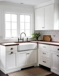 Gorgeous Cottage Kitchen Boasts White Shaker Cabinets Fitted With - White kitchen cabinets with butcher block countertops