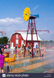 children and adults play at the new splash pad located at mckee