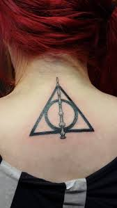 nice harry potter stick and hallows tattoo on upper back by trixena