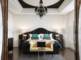 Mini Black Chandelier Stylish Bedroom With White Walls And King Size Bed Under Black