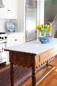 best 20 kitchen island table ideas on pinterest kitchen dining antique buffet table reimagined with a marble slab top and repurposed as kitchen island brilliant