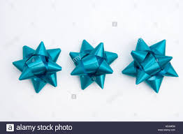 christmas gift bows three bright blue christmas gift bows in row on white background