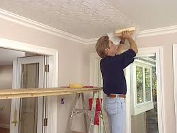 apply an embossed wallpaper ceiling treatment tos diy