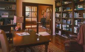 tudor architecture style additions remodels the warm colors and wood detail of the library exudes the coziness of tudor interiors