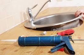 Sealant For Kitchen Sink Caulking Gun With Silicone Sealant Against Kitchen Sink