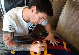 die hard football fan inks huge tattoo of lionel messi on his back