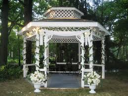 Pergola Wedding Decorations by There Was A Flute Quartet Seated In The Gazebo And Wedding Party