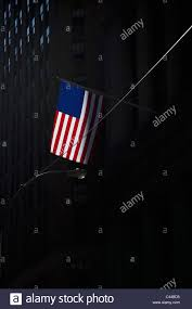 How Tall Is A Flag Pole American Flag On Flagpole Attached To Shadowed Tall Building Stock