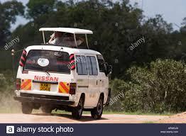 nissan van pop top nissan van on game drive tsavo national park kenya stock
