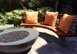 exterior back yard patio with fire bowl and black wcker chair