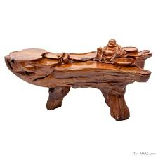 tree trunk coffee table with buddah motif manhattan art and