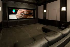 wall sconces for home theater black sofa on grey rug with rectangle screen and square white wall