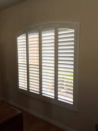 arch plantation shutters available from budget blinds shutters
