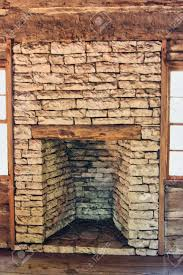 an old log cabin fireplace stock photo picture and royalty free