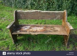 rustic bench seat made from rough cut tree planks the seat is