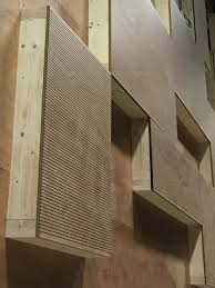 panneaux acoustiques bois salle multi sport bioclimatique decoupe placage bois et