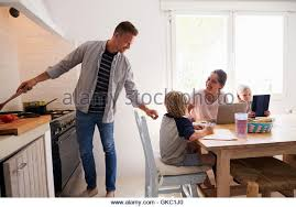 Kids Kitchen Table by Dad Cooking Mum Kids Kitchen Table Stock Photos U0026 Dad Cooking Mum
