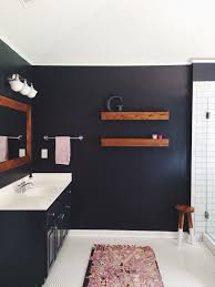 bathroom with dark walls white subway tile wrought iron by