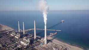smoking power plant red white chimneys wide shot hd high