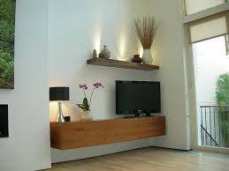 wood floating media cabinet for tv stand and black table lamp