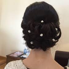 bun pins low bun with small flower pins wedding ideas