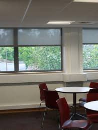roller blinds in screen fabric colour grey and farbic wrapped bottom bar 2 jpg