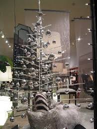 plastic tree with silver ornaments pictures photos and