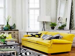 grey sofa with cushions also yellow wall paint decoration white