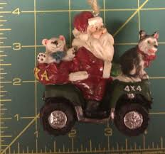 alaska christmas ornament santa claus on a 4 wheeler husky on