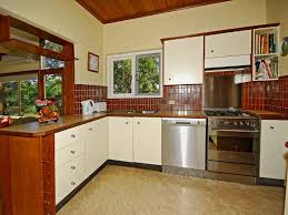 small l shaped kitchen design with tile backsplash and laminate