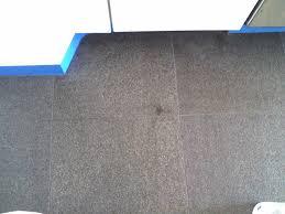 stains on granite floor tiles flamed finish how do i clean