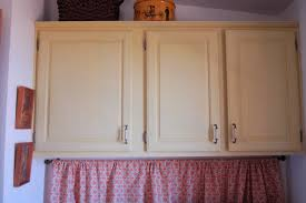 small shabby chic painted kitchen cabinets over wall