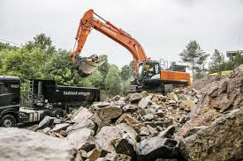 hitachi excavator picked for norwegian rock removal