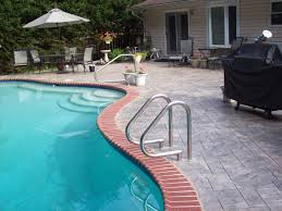 outdoor severna park pool design with resurface pool deck and