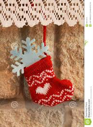 christmas stocking hanging in the fireplace stock photo image