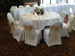gold chair sashes gold embroidered organza sashes on white chair covers at the crown