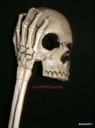 halloween skeleton mask halloween skull mask held with skeleton arm hand stick