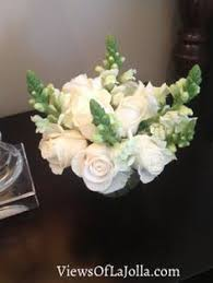 stunning white floral arrangements with white orchids for a 50th