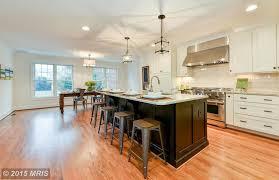 kitchen with hardwood floors u0026 complex granite counters in