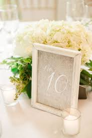 Wedding Table Numbers Ideas 16 Unique Table Number Ideas Weddingwire