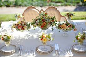spring outdoor wedding with single bloom centerpieces pink peonies